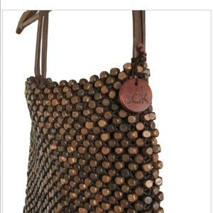 The Sak crochet wooden bead and leather purse